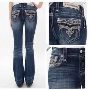 Rock Revival Sapphire Mid-Rise Boot Cut Jeans. 25